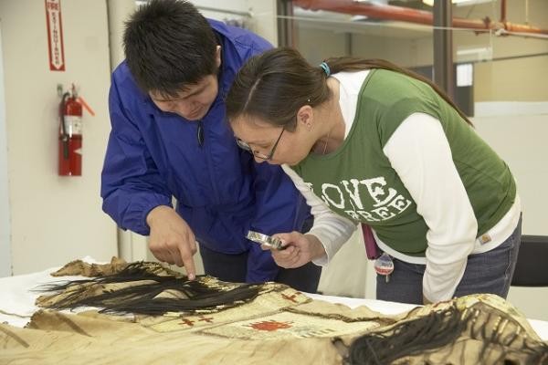trina and josh blackfoot participants in the blackfoot shirts project examine one of the ancestral shirts at the glenbow museum calgary alberta photograph owen melenka
