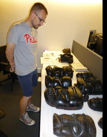 David Pratten examining Nigerian Masks