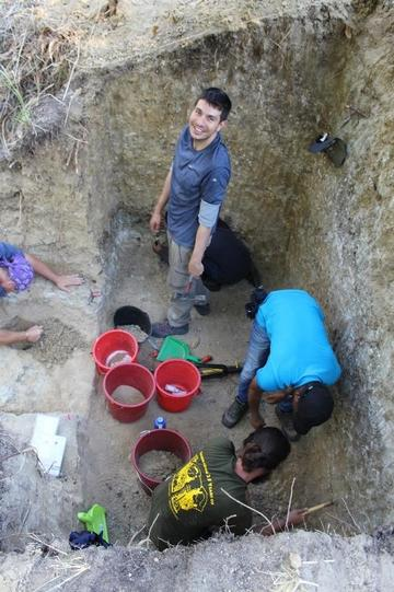 thomas puschel and joao coelho with students in the excavation pit