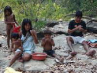 A Panará family enjoys a meal during a fishing trip, Brazil, 2007 (Photo by E. Ewart)