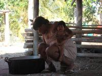 Panara woman with her granddaughter, preparing food, Brazil 2007 (Photo by E. Ewart)